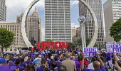 Detroit, Michigan USA: SEIU Security guards rally at the Labor Legacy Monument for union recognition at downtown buildings owned by businessman Dan Gilbert - Jim West - 2010s,2019,ACTIVIST,ACTIVISTS,against,America,american,americans,Bedrock,buildings,businessman,BUSINESSMEN,CAMPAIGNING,CAMPAIGNS,Dan Gilbert,DEMONSTRATING,demonstration,Detroit,EARNINGS,guards,Income,