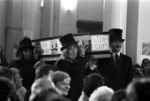 Meeting of campaign against cuts in social services, London 1984 - NLA - 1980s,1984,activist,activists,against,CAMPAIGNING,CAMPAIGNS,casket,CCSU,coffin,coffin bearing,cuts,DEMONSTRATING,Demonstration,FEMALE,London,male,man,Meeting,MEETINGS,member,member members,members,men