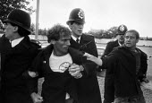 Arrest of a kent miner, mass picket, Barking Hospital, East London, threatened with privatisation of cleaning services - NLA - 1980s,1984,activist,activists,adult,adults,against,arrest,arrested,arresting,Barking Hospital,CAMPAIGNING,CAMPAIGNS,cleaning,cleansing,CLJ,COHSE,DEMONSTRATING,Demonstration,DISPUTE,disputes,force,Hosp