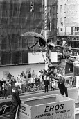 Eros, Piccadilly, London, 1984 is lifted by crane before being put into a box and taken away for repairs. - Peter Arkell - 10-08-1984