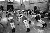 Youth in the gymnasium, Send Detention Centre, Woking, Surrey, 1979. Short, sharp shock correction centre. - Martin Mayer - 27-11-1979
