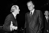 American evangelist Billy Graham (L) with Anthony Barber, Institute of Directors Annual Conference, 1971 London - Martin Mayer - 1970s,1971,American,americans,Anthony Barber,Belief,Billy Graham,Christian,christianity,christians,communicating,communication,Conference,conferences,CONSERVATIVE,Conservative Party,conservatives,conv