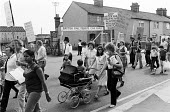 Protest against British Rail removing blue asbestos from a shed, Ilford, East London 1979 - NLA - 1970s,1979,activist,activists,adult,adults,against,asbestos,ASBESTOSIS,Asian,Asians,BAME,BAMEs,Black,Black and White,BME,bmes,CAMPAIGNING,CAMPAIGNS,child,CHILDHOOD,children,Community protest,DEMONSTRA