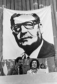 Hortensia Allende, widow of Salvador Allende, president of Chile, speaking at a Chile protest against the Military Coup 1973, London, infront of a banner depicting Salvador Allende - NLA - 1970s,1974,activist,activists,against,CAMPAIGNING,CAMPAIGNS,Chile,Chile solidarity campaign,chilean,chileans,coup,DEMONSTRATING,Demonstration,Hortensia Bussi,London,Military,military coup,Mrs Allende,