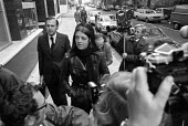 John Stonehouse MP going into court with his wife 1975 on various charges including theft and fraud, London. Earlier he had faked his own death leaving a pile of clothes on a beach in Miami, then made... - NLA - 13-10-1975