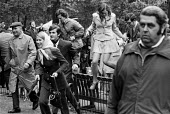 Jumping fences while trying to catch a glimpse of the queen 1972 at the annual Trooping the Colour, St James Park, London. - Peter Arkell - 03-06-1972