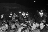 Police horses charge picket line, Wapping dispute, East London, 1986 - Peter Arkell - 28-02-1986