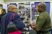 Detroit, Michigan, USA: US Border Patrol officer recruiting, job fair, NAACP Annual Convention - Jim West - 2010s,2019,African American,African Americans,African-American,America,american,americans,BAME,BAMEs,black,BME,bmes,Border,Border Patrol,civil rights,CLJ,communicating,communication,convention,convers