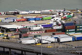 Lorries waiting to board a cross channel ferry at the Eastern Docks, Port of Dover, Kent. - Philip Wolmuth - 2010s,2019,boat,boats,capitalism,cross channel,Cross Channel Ferry,Customs Officer,customs officers,DOCK,Docks,EBF,Economic,Economy,Eddie Stobart,export,exporting,exports,ferries,ferry,harbor,harbors,