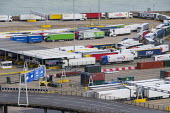 Lorries waiting to board a cross channel ferry at the Eastern Docks, Port of Dover, Kent. - Philip Wolmuth - 2010s,2019,boarding,boat,boats,capitalism,cross channel,Cross Channel Ferry,Customs Officer,customs officers,DOCK,Docks,EBF,Economic,Economy,export,exporting,exports,ferries,ferry,harbor,harbors,harbo