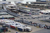 Lorries and cars waiting to board a cross channel ferry at the Eastern Docks, Port of Dover, Kent. - Philip Wolmuth - 2010s,2019,AUTO,AUTOMOBILE,AUTOMOBILES,boat,boats,capitalism,car,cars,cross channel,Cross Channel Ferry,DOCK,Docks,EBF,Economic,Economy,export,exporting,exports,ferries,ferry,harbor,harbors,harbour,ha