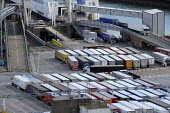 Lorries waiting to board a cross channel ferry at the Eastern Docks, Port of Dover, Kent. - Philip Wolmuth - 2010s,2019,ARRIVAL,arrivals,arrive,arrives,arriving,boat,boats,capitalism,cross channel,Cross Channel Ferry,disembark,disembarkation,disembarking,DOCK,Docks,EBF,Economic,Economy,export,exporting,expor