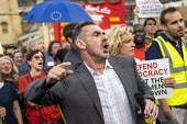 Paul Mason speaking Defend democracy, resist the Parliament Shutdown protest as the Queen agrees to suspend Parliament at Boris Johnsons request, College Green, Westminster, London. - Jess Hurd - 2010s,2019,activist,activists,against,Boris Johnson,Brexit,CAMPAIGN,campaigner,campaigners,CAMPAIGNING,CAMPAIGNS,civil rights,College,College Green,COLLEGES,Defend democracy,democracy,DEMONSTRATING,de