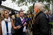 Journalist John Pilger being interviewed by Russian news tv crews, Protest against threatened extradition of imprisoned WikiLeaks journalist Julian Assange, Home Office, London - Stefano Cagnoni - 02-09-2019