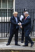 Benjamin Netanyahu is welcomed by Boris Johnson into No. 10 Downing Street, Westminster, London. - Jess Hurd - 2010s,2019,Benjamin Netanyahu,Boris Johnson,CONSERVATIVE,Conservative Party,conservatives,Downing Street,greeting,Likud-National Liberal Movement,London,POL,political,POLITICIAN,POLITICIANS,Politics,S