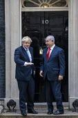 Benjamin Netanyahu is welcomed by Boris Johnson into No. 10 Downing Street, Westminster, London. - Jess Hurd - 2010s,2019,Benjamin Netanyahu,Boris Johnson,CONSERVATIVE,Conservative Party,conservatives,Downing Street,Likud-National Liberal Movement,London,POL,political,POLITICIAN,POLITICIANS,Politics,Street,Wes