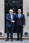 Mike Pence is welcomed by Boris Johnson into No. 10 Downing Street, Westminster, London. - Jess Hurd - 2010s,2019,Benjamin Netanyahu,Boris Johnson,CONSERVATIVE,Conservative Party,conservatives,Downing Street,greeting,London,Mike Pence,POL,political,POLITICIAN,POLITICIANS,Politics,Republican Party,repub