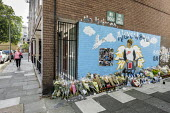 Mural and flowers commemorating the fatal stabbing of 16 year old Alex Smith in August 2019, Munster Square, Regent's Park Estate, Camden, London - Philip Wolmuth - 2010s,2019,adolescence,adolescent,adolescents,attack,attacking,attacks,bouquet,bunch of,Camden,child,CHILDHOOD,children,cities,City,CLJ,COMMEMORATE,commemorating,commemoration,COMMEMORATIONS,commemora