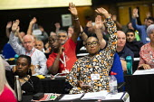 Delegates voting, TUC Congress, Brighton 2019. - Jess Hurd - 2010s,2019,BAME,BAMEs,BEMM,BEMMS,Black,BME,bmes,Brighton,Conference,conferences,DELEGATE,Delegates,democracy,diversity,ethnic,ethnicity,FEMALE,member,member members,members,minorities,minority,people,