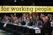 PCS delegates voting, TUC Conference, Brighton, 2019 - John Harris - 2010s,2019,Conference,conferences,delegate,delegates,delegation,democracy,FEMALE,Hands up,member,member members,members,PCS,people,person,persons,Trade Union,Trade Union,Trade Unions,Trades Union,Trad