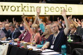 Delegates voting, TUC Conference, Brighton, 2019 - John Harris - 2010s,2019,Conference,conferences,delegate,delegates,democracy,Hands up,member,member members,members,PCS,people,Trade Union,Trade Union,Trade Unions,Trades Union,Trades Union,Trades unions,TUC,TUC Co