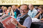 Photographer John Harris reading the Morning Star, TUC Congress, Brighton 2019 - Jess Hurd - 09-09-2019