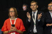 Sian Jones, Head of Media, Seumas Milne labour Party Director of Communications listening to Jeremy Corbyn speaking, TUC Conference, Brighton, 2019 - John Harris - 13-09-2019