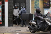 Uber Eats riders waiting for work, Brighton - John Harris - 2010s,2019,courier,couriers,deliveries,delivering,delivery,EARNINGS,EBF,Economic,Economy,employee,employees,Employment,foreign,foreigner,foreigners,immigrant,immigrants,Income,insecure,insecurity,job,