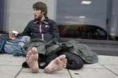 Homeless young man with bleeding feet, Brighton - John Harris - 2010s,2019,beg,beggar,beggars,BEGGER,begging,begs,bleeding,blood,emotion,emotional,emotions,excluded,exclusion,feet,foot,HARDSHIP,homeless,homelessness,impoverished,impoverishment,INEQUALITY,male,man,