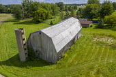Adair, Michigan, USA: Old barn with the remains of a concrete gain silo - Jim West - aerial,agricultural,agriculture,american,americans,barn,building,buildings,capitalism,concrete,concrete silo,country,decaying,decrepit,disused,EBF,Economic,Economy,farm,farmed,farming,farmland,farms,f