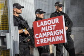 Remain poster and armed police outside Labour Party Conference, Brighton, 2019 - Jess Hurd - 2010s,2019,adult,adults,armed,armed police,Armed police officer,brexit,Brighton,CLJ,Conference,conferences,EU,European Union,force,G36s,gun,guns,Heckler & Koch G36,Labour Party Conference,MATURE,OFFIC