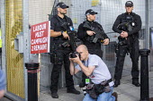 Remain poster and armed police outside Labour Party Conference, Brighton, 2019 - Jess Hurd - 2010s,2019,adult,adults,armed,armed police,Armed police officer,brexit,Brighton,camera,cameras,CLJ,Conference,conferences,EU,European Union,force,G36s,gun,guns,Heckler & Koch G36,Labour Party Conferen