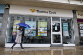 Closed shop of package holiday operator Thomas Cook now in compulsory liquidation, with the loss of all 21,000 jobs, Leamington Spa, Warwickshire - John Harris - 2010s,2019,bankrupt,bankruptcy,Business,close,closed,closing,closure,closures,Cook,COOKS,DOWNTURN,EBF,Economic,Economy,High St,High Street,holiday,HOLIDAYS,insolvency,insolvent,operator,OPERATORS,outl