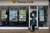 Closed shop of package holiday operator Thomas Cook now in compulsory liquidation, with the loss of all 21,000 jobs, Leamington Spa, Warwickshire - John Harris - 2010s,2019,bankrupt,bankruptcy,bought,Business,buying,close,closed,closing,closure,closures,consumer,consumers,Cook,COOKS,customer,customers,DOWNTURN,EBF,Economic,Economy,High St,High Street,holiday,H