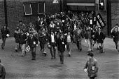 Car workers leaving work, Vauxhall, Ellesmere Port, 1979 - Martin Mayer - 1970s,1979,AUTO,AUTOMOBILE,AUTOMOBILES,automotive,Car,Car Industry,car worker,Car workers,carindustry,CARS,change,coming off,EBF,Economic,Economy,Ellesmere Port,employee,employees,Employment,end,endin