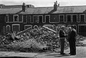Demolition of terraced houses Birkenhead 1979. Terraced houses in near Liverpool are bricked up prior to being demolished and replaced with high rise blocks - Martin Mayer - 04-05-1979