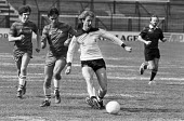 Hilary Benn playing for the GLC team in a football match against a chess grandmasters team, Fulham football ground, West London 1984 - NLA - 30-04-1984