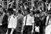 Martin Webster, National Front march, London, 1979 - NLA - 1970s,1979,activist,activists,adult,adults,against,bigotry,CAMPAIGNING,CAMPAIGNS,CLJ,DEMONSTRATING,Demonstration,DISCRIMINATION,Far Right,Far Right,fascism,Fascist,Fascists,flag,flags,force,INEQUALITY