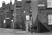Back to back housing, Toxteth, Liverpool, 1972 with each house having common walls at the back and the sides, and with a narrow ally between the rows - NLA - 19-08-1972