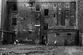 Children playing. Slum housing, Glasgow, 1972 with people still living in old tenement blocks - NLA - 05-01-1972