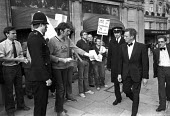 Keith Joseph refusing a leaflet from civil servants in dispute with the government over pay, on his way into a CBI dinner, Mayfair, London 1981 - Peter Arkell - 1980s,1981,CBI,civil servants pay dispute,confront,confrontation,confronted,confronting,CONSERVATIVE,Conservative Party,conservatives,CPSA,dinner,dinners,dispute,disputes,government,Industrial dispute
