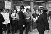 Keith Joseph refusing a leaflet from civil servants in dispute with the government over pay, on his way into a CBI dinner, Mayfair, London 1981 - Peter Arkell - 1980s,1981,CBI,civil servants pay,civil servants pay dispute,confront,confrontation,confronted,confronting,CONSERVATIVE,Conservative Party,conservatives,CPSA,dinner,dinners,dispute,disputes,government