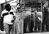 Police with long riot shields, Brixton, London 1985 - Peter Arkell - 28-09-1985
