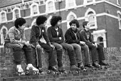 Youth with roller skates, Stockwell Park Estate, Lambeth, London 1981 - Peter Arkell - ,1980s,1981,adolescence,adolescent,adolescents,BAME,BAMEs,Black,Black and White,BME,bmes,boy,boys,child,children,cities,City,council estate,Council Housing,council estate,Council Housing,council servi