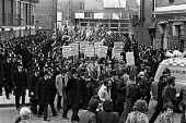 Police escort a National Front march, Peckham, London 1980 - Ray Rising - 1980,1980s,activist,activists,adult,adults,against,CAMPAIGNING,CAMPAIGNS,cities,City,DEMONSTRATING,Demonstration,far right,far right,fascism,Fascist,fascists,London,National Front,NF,placard,placards,