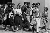 Teddy boys and girls march to Elvis Presley Memorial Service, Christ Church Cockfosters, London 1977 - Ray Rising - 1970s,1977,ace,adolescence,adolescent,adolescents,Church,churches,cities,City,culture,Elvis,Elvis memory march,entertainment,fan,fans,FEMALE,Leisure,LFL,LIFE,Lifestyle,London,male,man,Memorial,men,peo