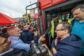 Jeremy Corbyn is greeted by bus drivers, Big Canvass with Jeremy Corbyn and Faiza Shaheen, PPC, Chingford and Woodford Green, Iain Duncan Smith constituency. London. - Jess Hurd - 28-09-2019