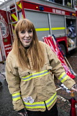 Angela Rayner MP in firefighters jacket, End Austerity Now, Protest the Tory Party Conference, Manchester, 2019 - Jess Hurd - 2010s,2019,activist,activists,adult,adults,against,Angela Rayner,Austerity,CAMPAIGN,campaigner,campaigners,CAMPAIGNING,CAMPAIGNS,Conference,conferences,CONSERVATIVE,Conservative Party,Conservative Par