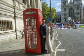 Bride and groom pose for wedding photos as Extinction Rebellion protest against lack of Government action on climate change. Nonviolent direct action shutting down central London. - Jess Hurd - 2010s,2019,activist,activists,adult,adults,against,Bride,BT,CAMPAIGNING,CAMPAIGNS,cities,City,couple,COUPLES,DEMONSTRATING,demonstration,DEMONSTRATIONS,environment,Extinction Rebellion,getting married