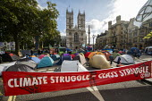 Extinction Rebellion protest against lack of Government action on climate change. Nonviolent direct action shutting down central London. Climte struggle is Class struggle - Jess Hurd - 09-10-2019